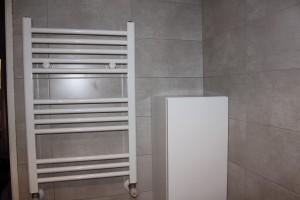 cambio de radiador por toallero en baño