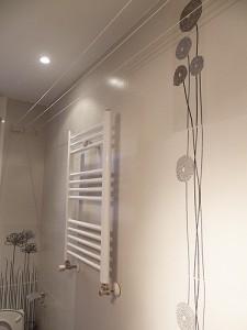 baño reformado toallero en pared