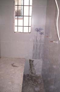 proceso de reforma de baño alicatado de paredes
